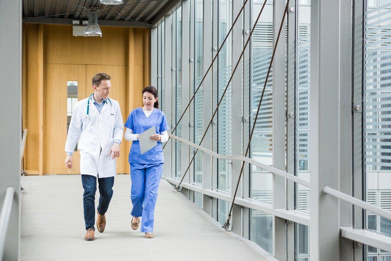 Medical team walking down hallway at the hospital