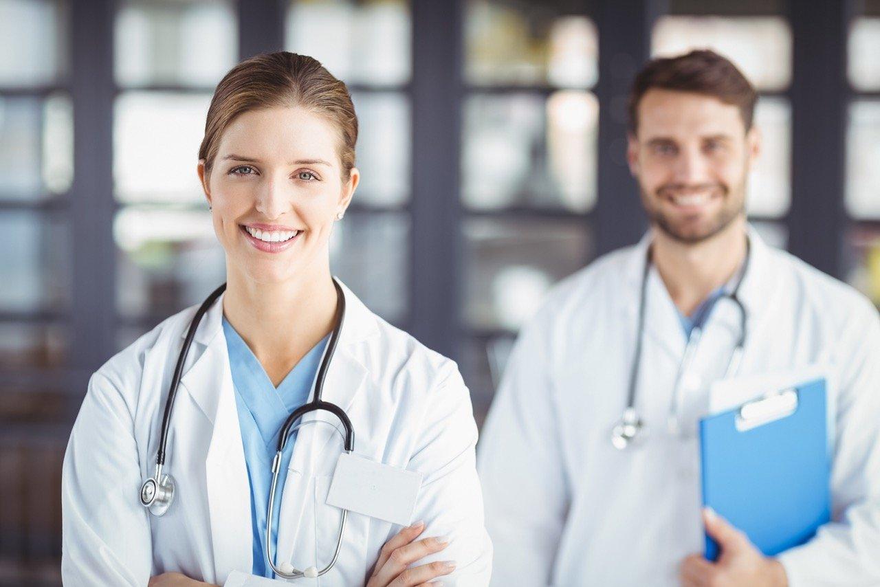 Portrait of smiling doctors standing in hospital