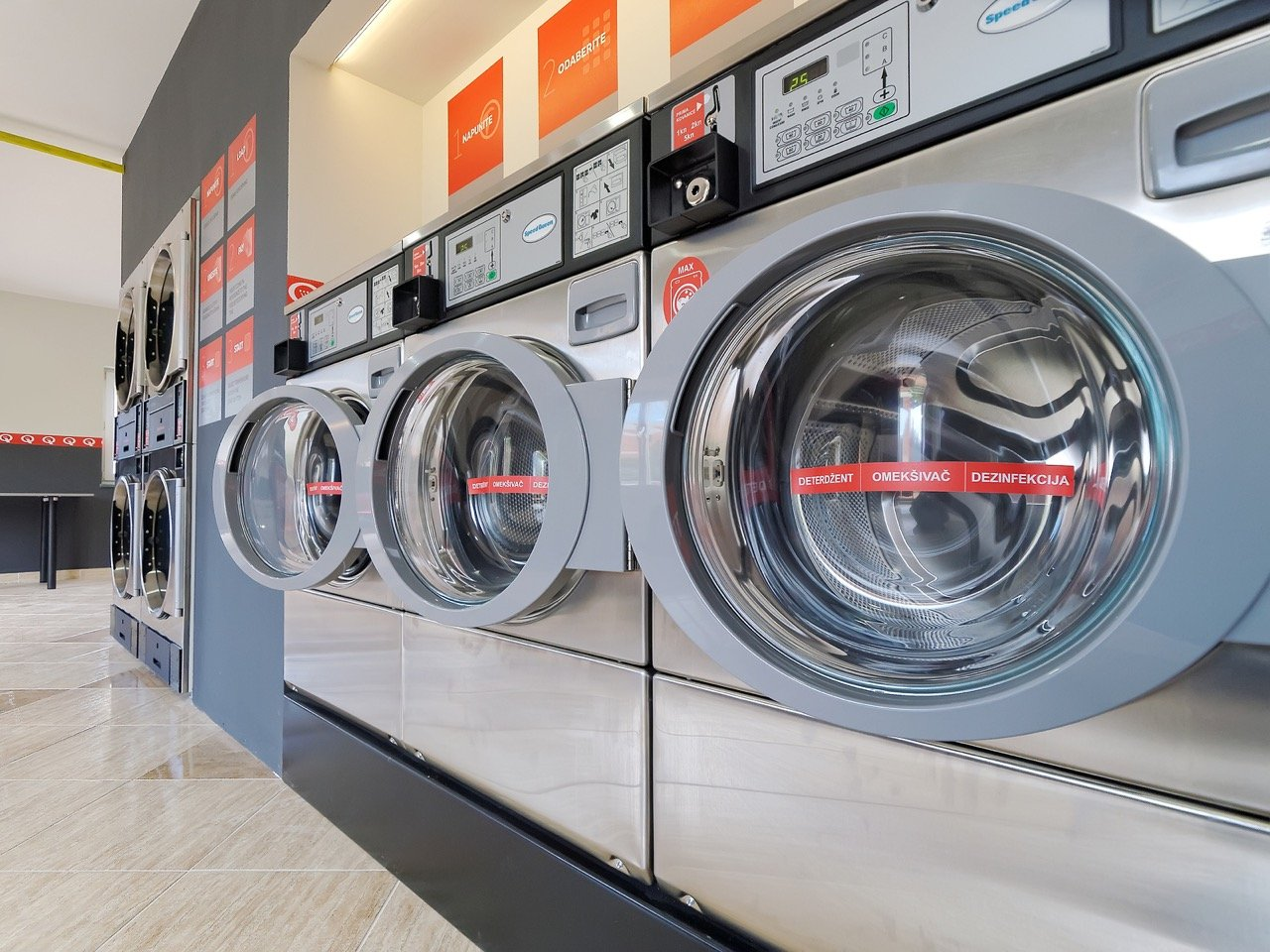 PULA, CROATIA - MAY 4, 2016: Speedy Queen coin operated laundromat washing and drying machine in Pula Croatia.